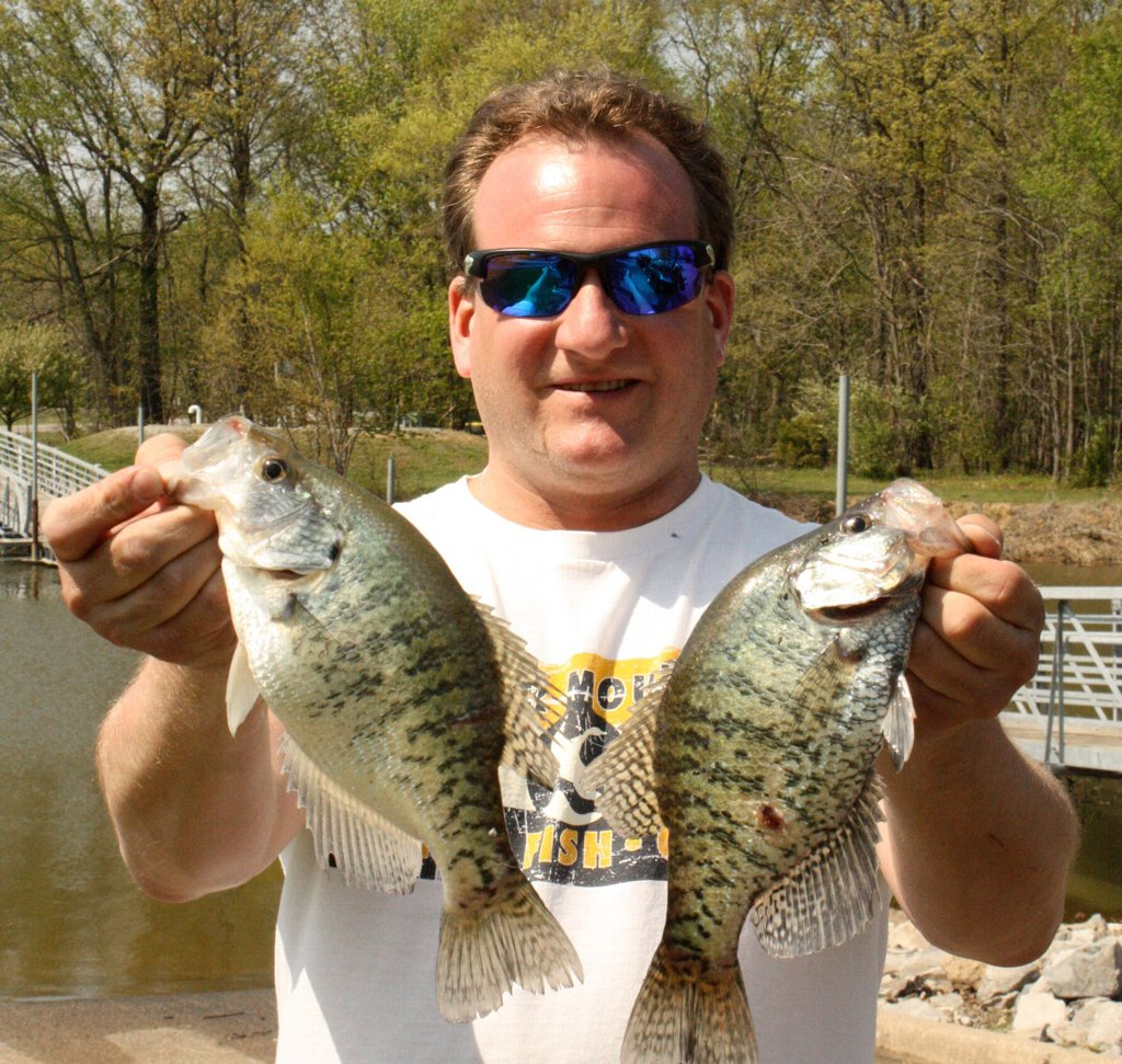 Another happy Boneyard Fishing client with a couple nice Rend Lake crappie